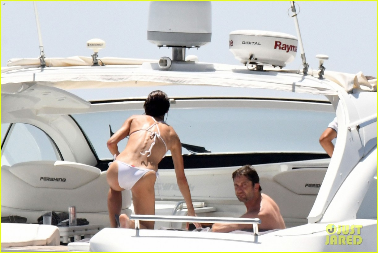 gerard butler girlfriend morgan brown romantic boat ride in italy 323706608