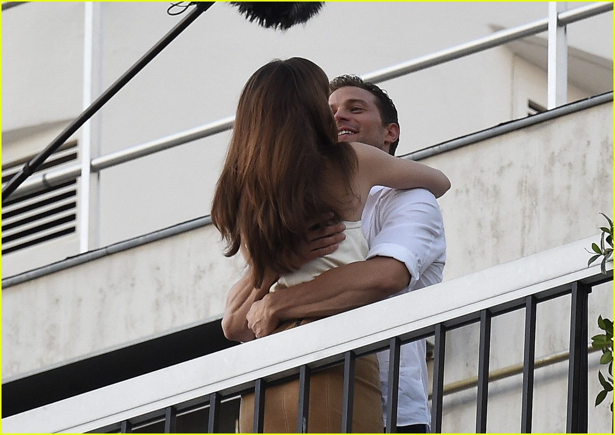 Jamie Dornan u0026 Dakota Johnson Kiss Overlooking the Eiffel ...