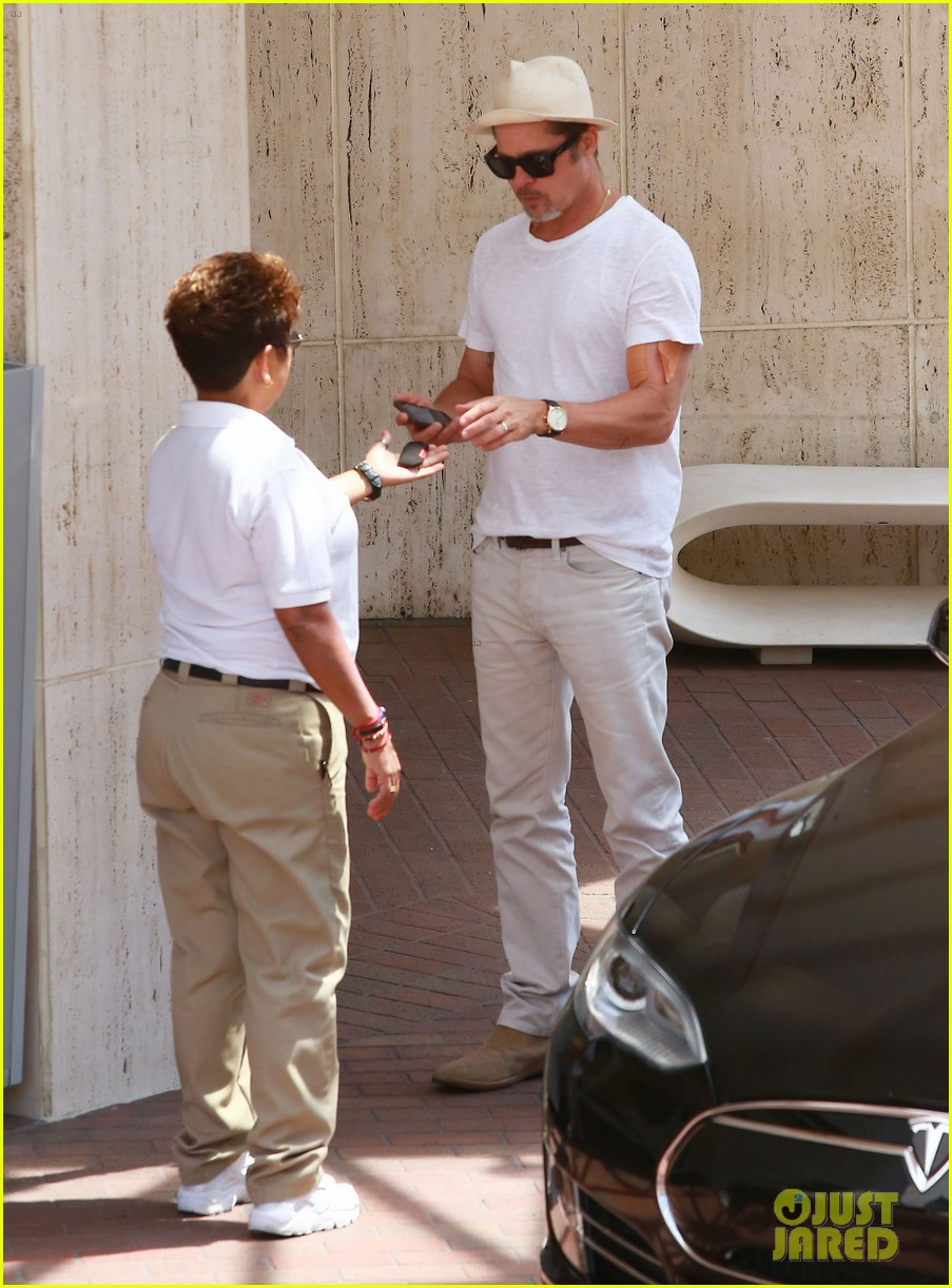 brad pitt sports an arm bandage while shopping with maddox 123720627