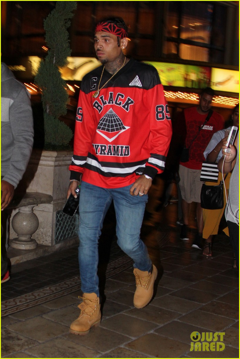 chris brown sees a movie at the grove gets followed by his female fans 053735505