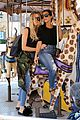 kourtney khloe kardashian ride a merry go round together 20
