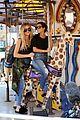 kourtney khloe kardashian ride a merry go round together 24