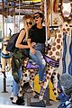 kourtney khloe kardashian ride a merry go round together 26