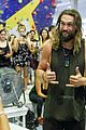 jason momoa biceps are bulging all over on the climbing wall 07