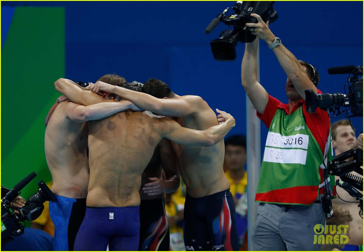 michael phelps picks up 21st gold medal after ripping his cap 033730130