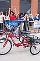 gabby sidibe competes in tricycle race with harry connick jr 03