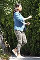mila kunis bares her baby bump while visiting a friends house 09