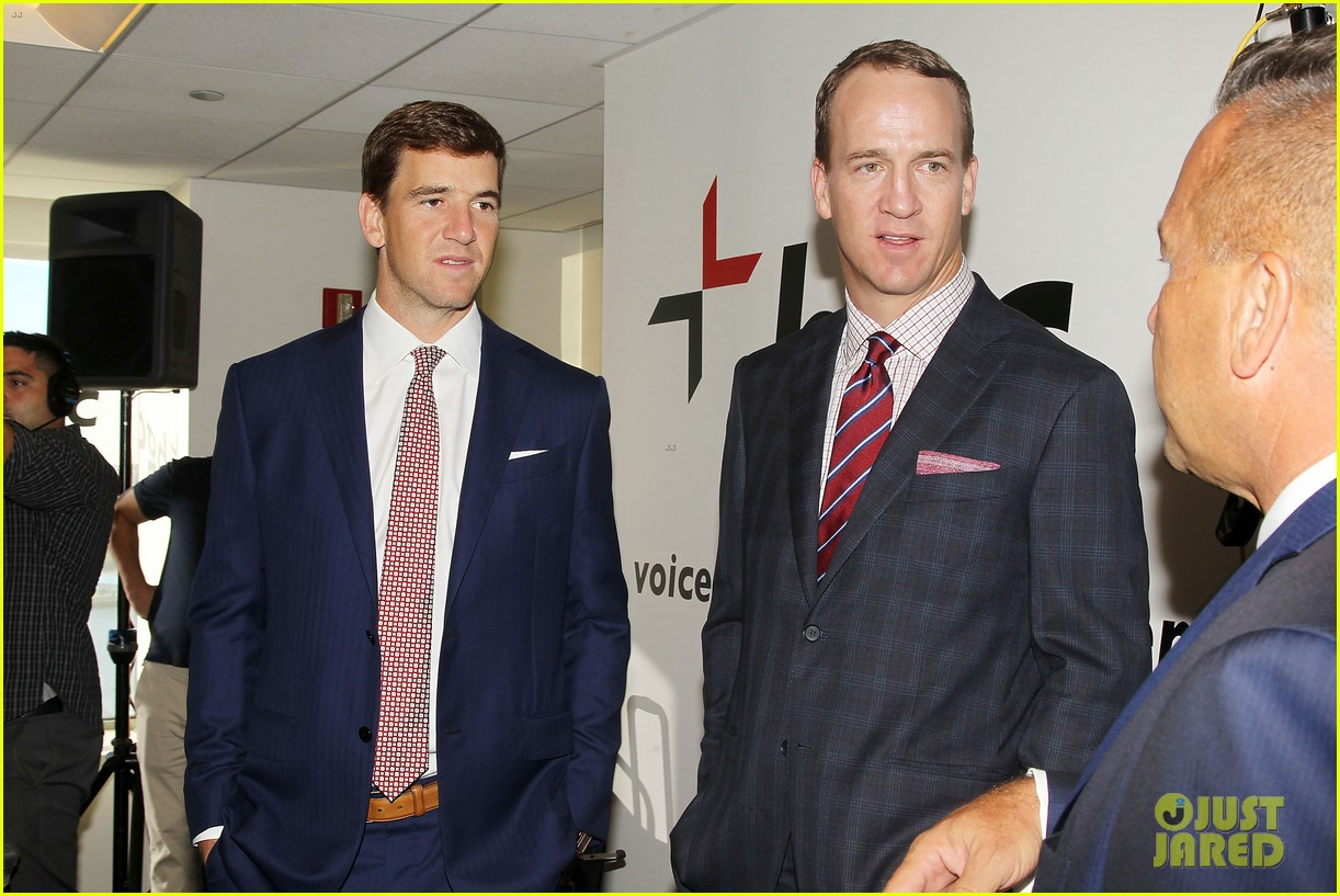 eli peyton manning join other celebs at 911 charity day 043757624