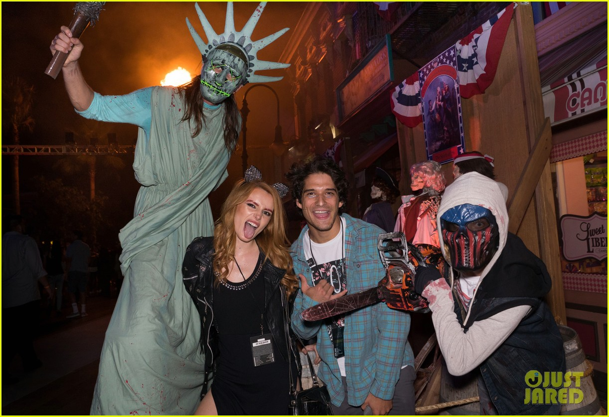 bella thorne tyler posey couple up at halloween horror nights 013777703
