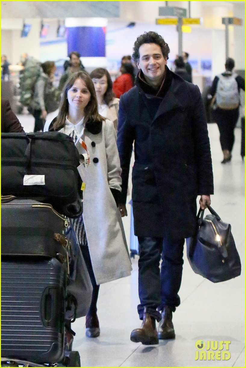 felicity jones holds hands with boyfriend charles guard at jfk 173816617