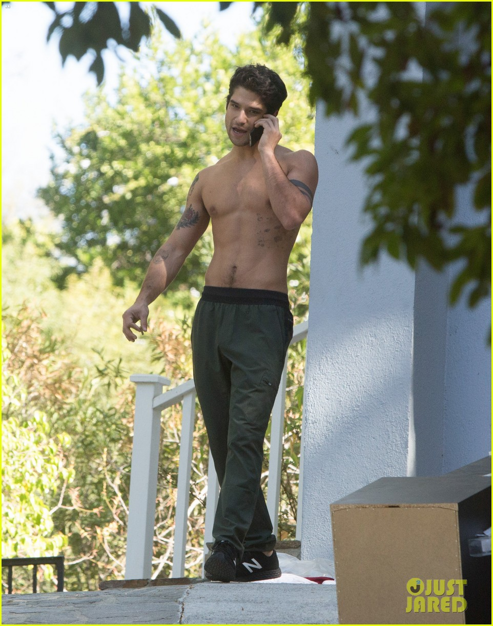 tyler posey goes shirtless as he works on his motorcycle 073805035