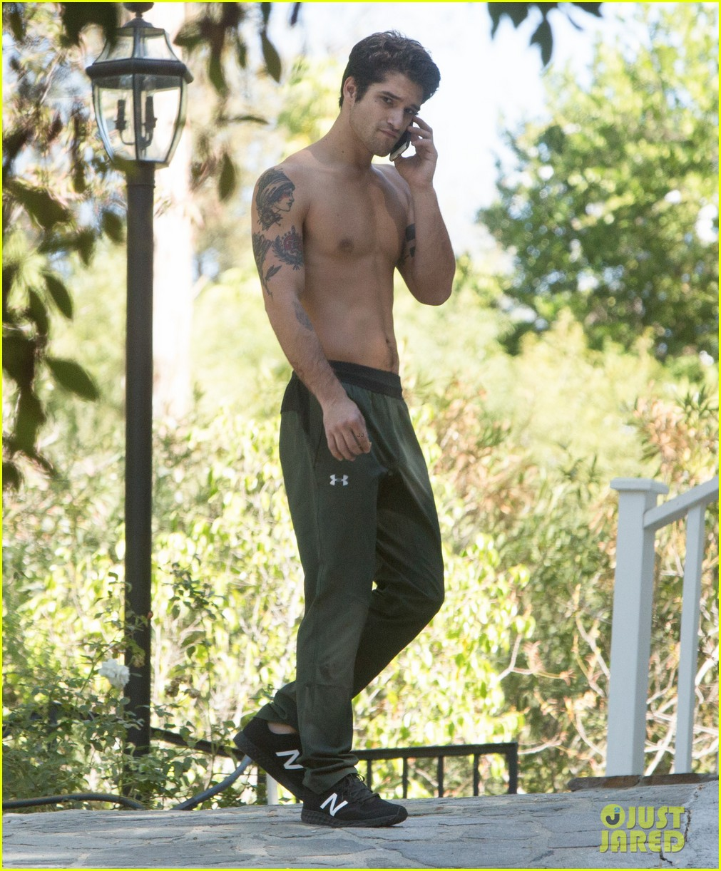 tyler posey goes shirtless as he works on his motorcycle 093805037
