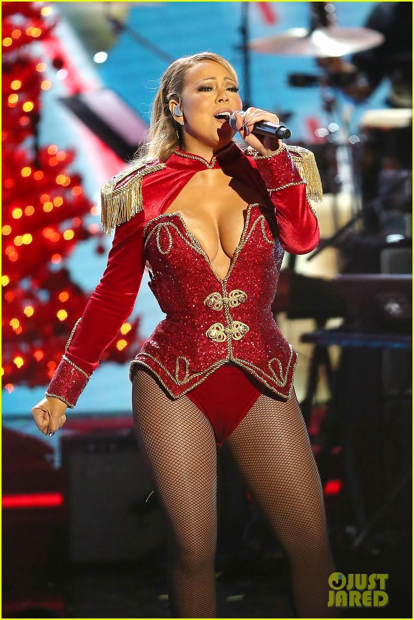 Mariah Carey Holds Bryan Tanaka's Hand On Stage at Christmas ...