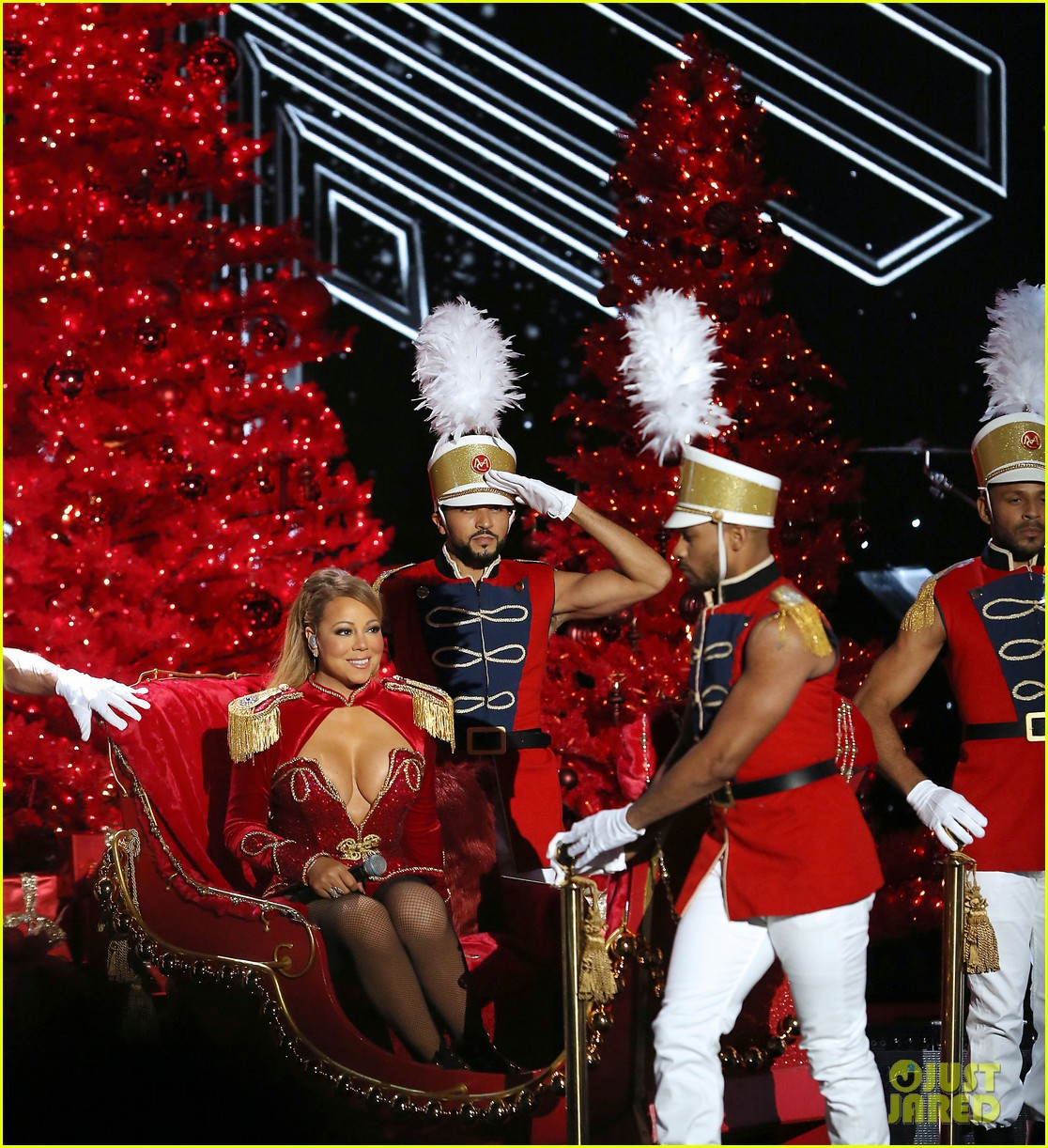 mariah carey holds bryan tanakas hand on stage at christmas concert