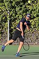 bradley cooper works on his serve on the tennis court 04