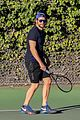 bradley cooper works on his serve on the tennis court 12