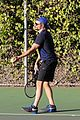 bradley cooper works on his serve on the tennis court 13