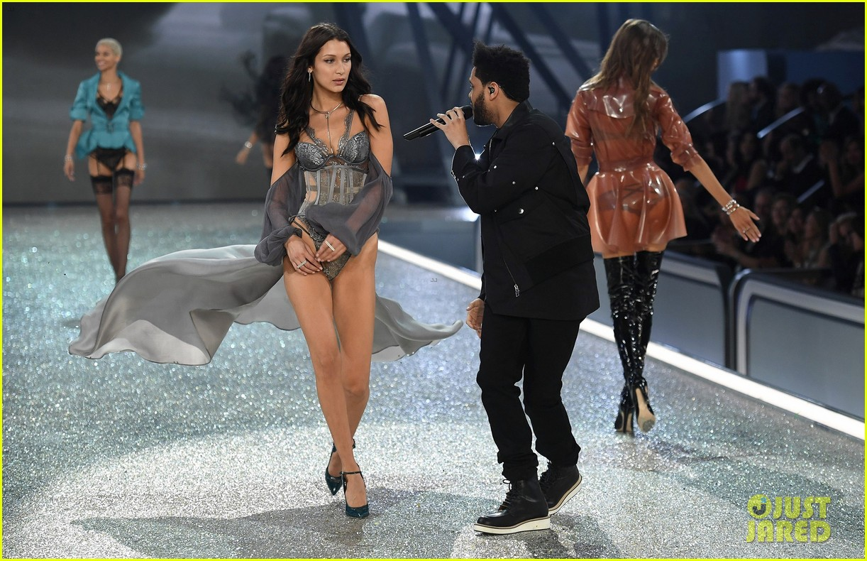 ad60cef9c48 VIDEO  Watch Bella Hadid   The Weeknd Cross Paths on Victoria s Secret  Runway!