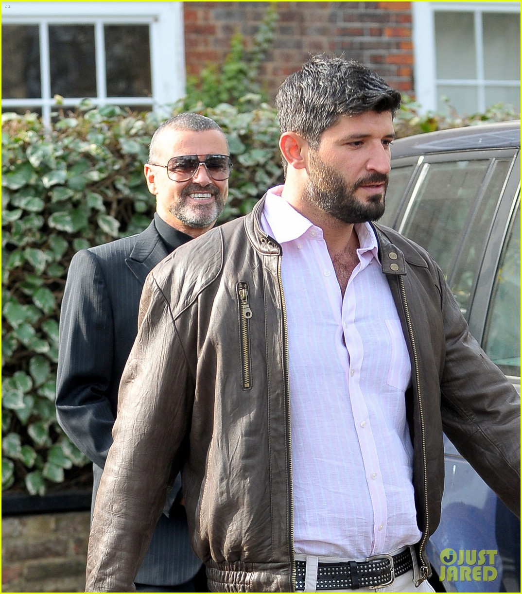 George michael s boyfriend tweets about finding him dead in bed photo