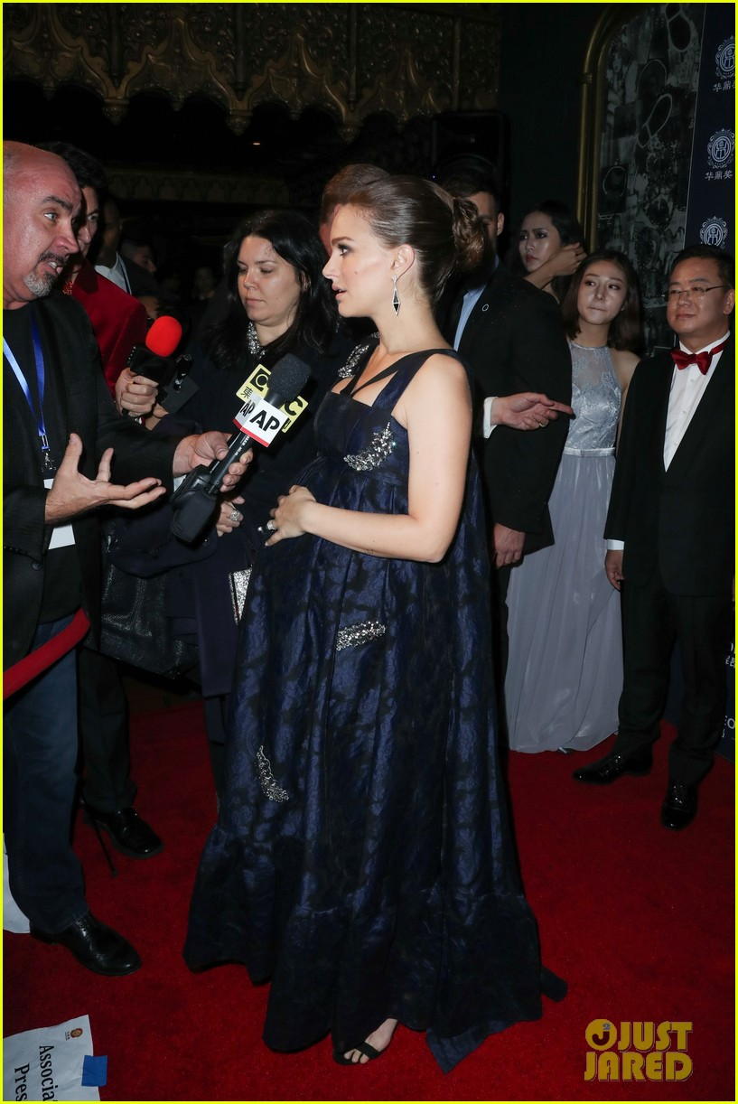 Natalie Portman Holds Onto Her Baby Bump at Huading Global