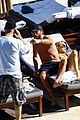 scott disick cuddles by the pool with another woman in miami 21