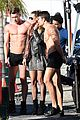 heidi klum surrounded by shirtless guys while filming gntm 05