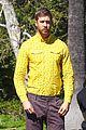 calvin harris rocks a yellow shirt during a photoshoot 01