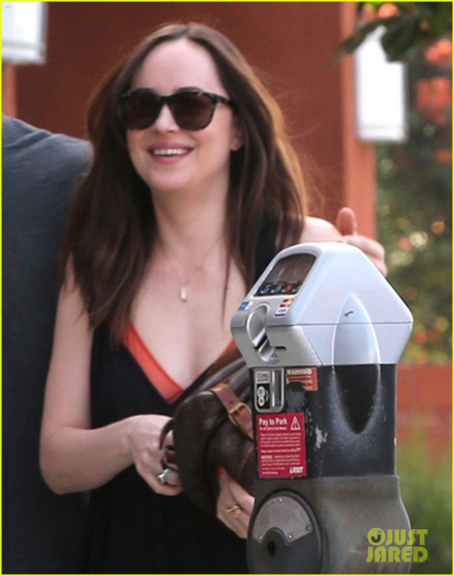 dakota johnson is all smiles alongside her personal trainer 093876550