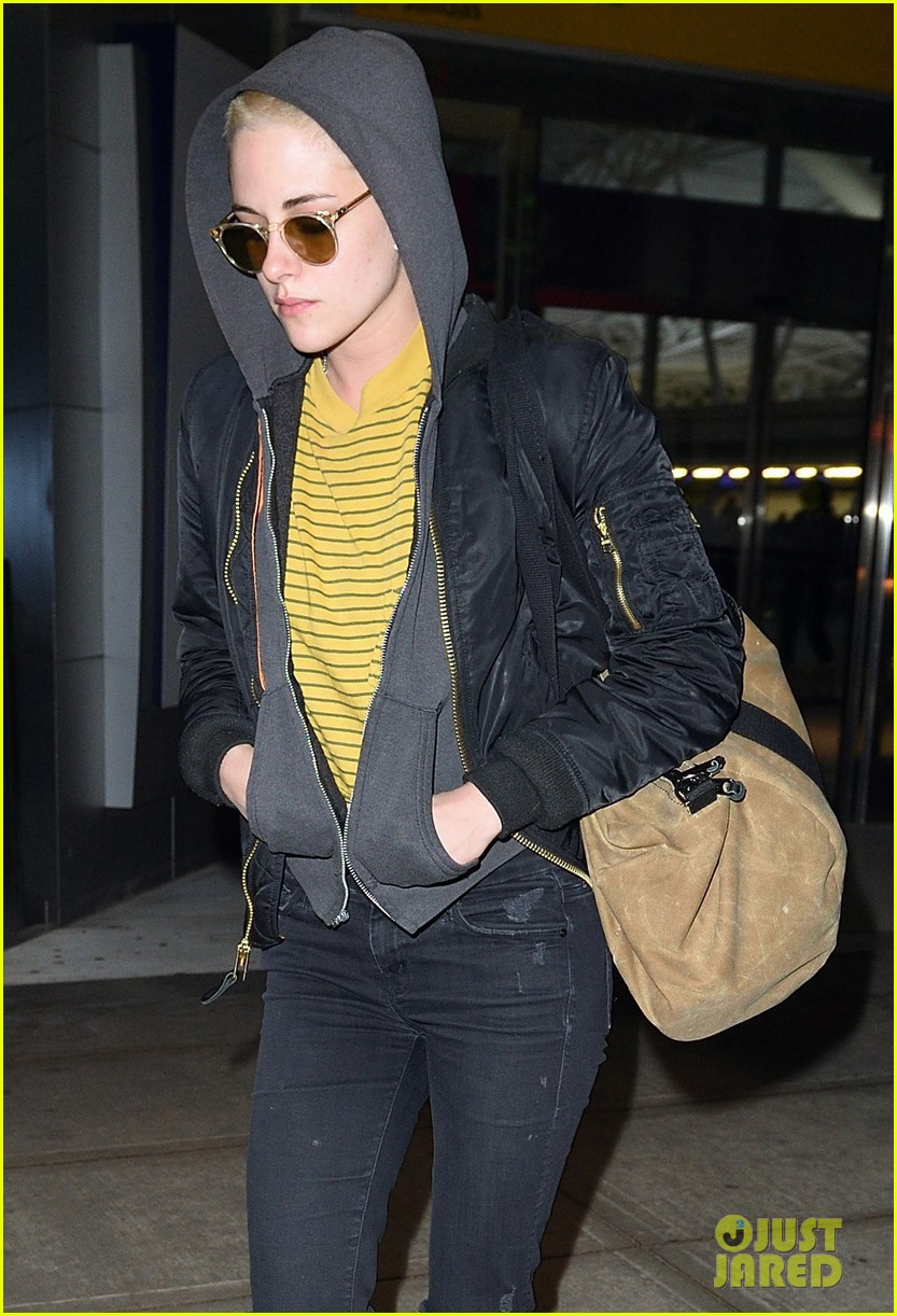 kristen stewart covers up new buzzed hair arriving in nyc 023871679