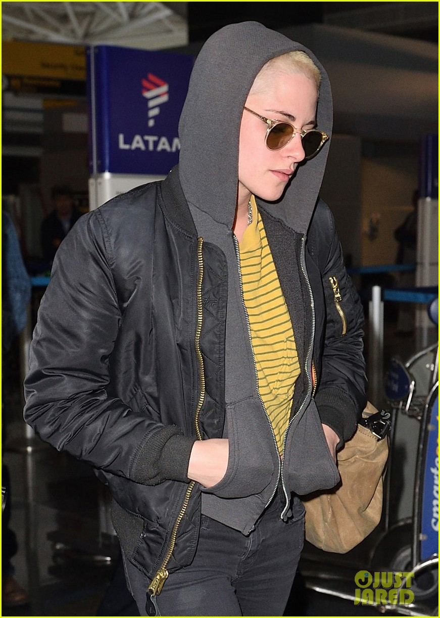 kristen stewart covers up new buzzed hair arriving in nyc 043871681