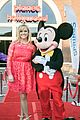 reese witherspoon attends grand opening of planet hollywood disney springs 01