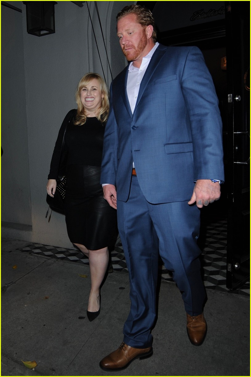 rebel wilson holds hands mystery man 013874356