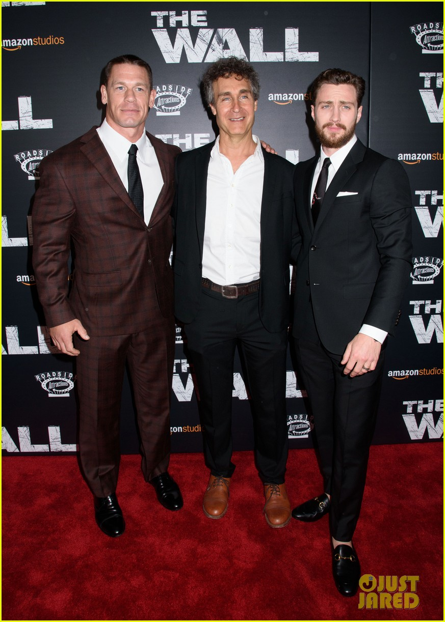 aaron taylor johnson john cena couple up at the wall premiere 033891501