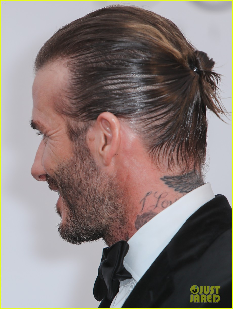 david beckham pulls his hair back at amfar cannes gala 023905756