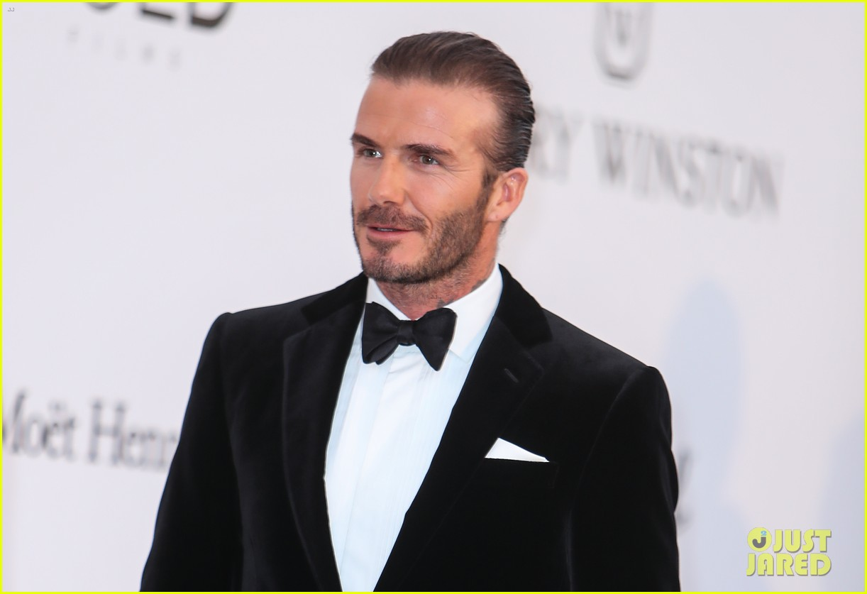 david beckham pulls his hair back at amfar cannes gala 073905761
