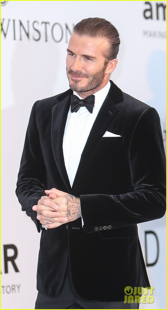 david beckham pulls his hair back at amfar cannes gala 083905762