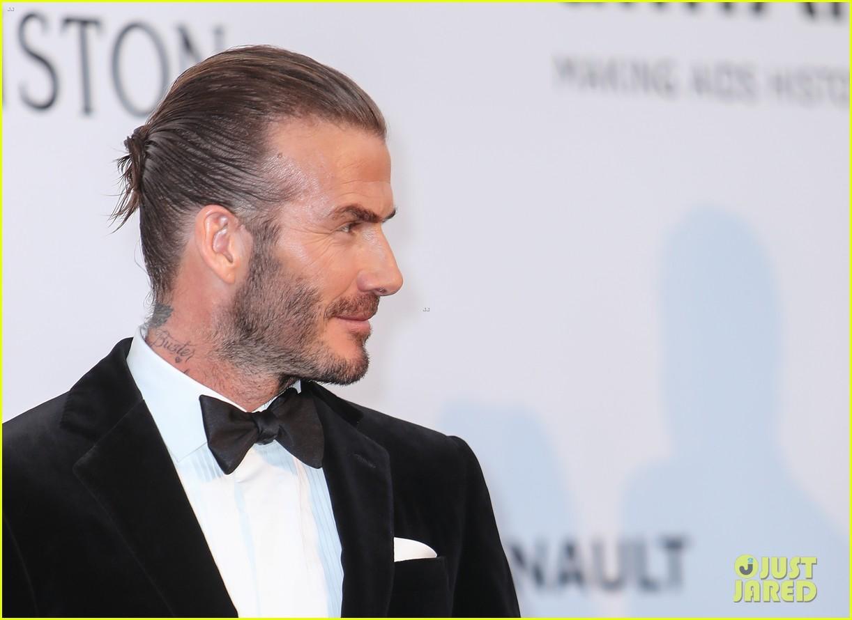 david beckham pulls his hair back at amfar cannes gala 093905763