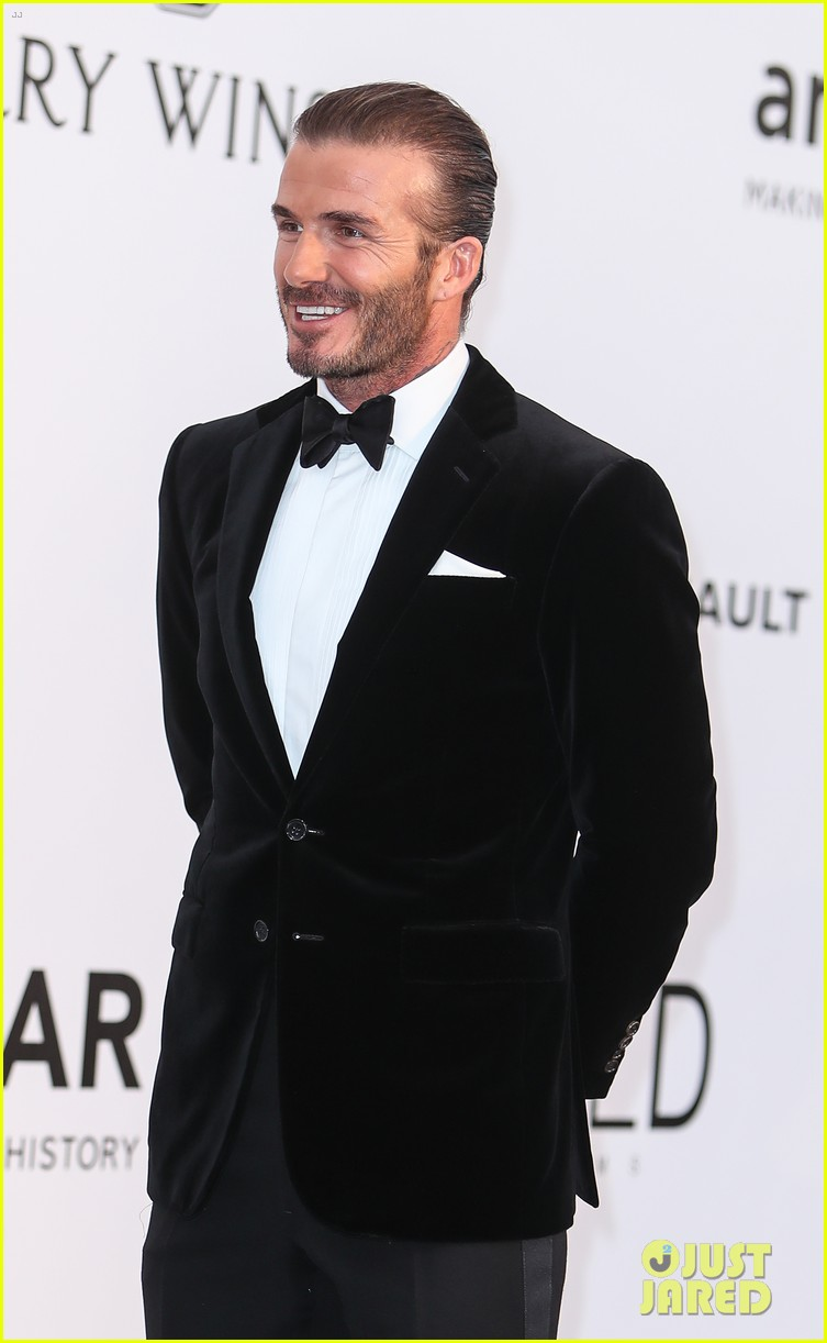 david beckham pulls his hair back at amfar cannes gala 113905765