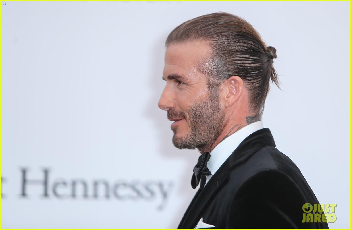 david beckham pulls his hair back at amfar cannes gala 243905778