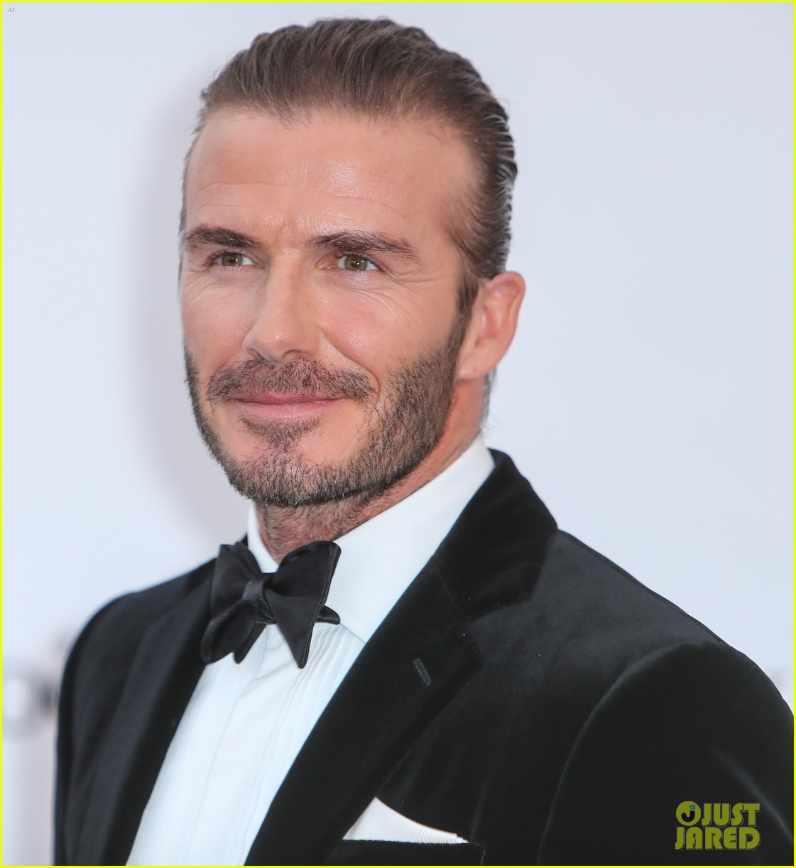 david beckham pulls his hair back at amfar cannes gala 263905780
