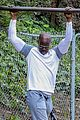 djimon hounsou shows his muscle while working out 02