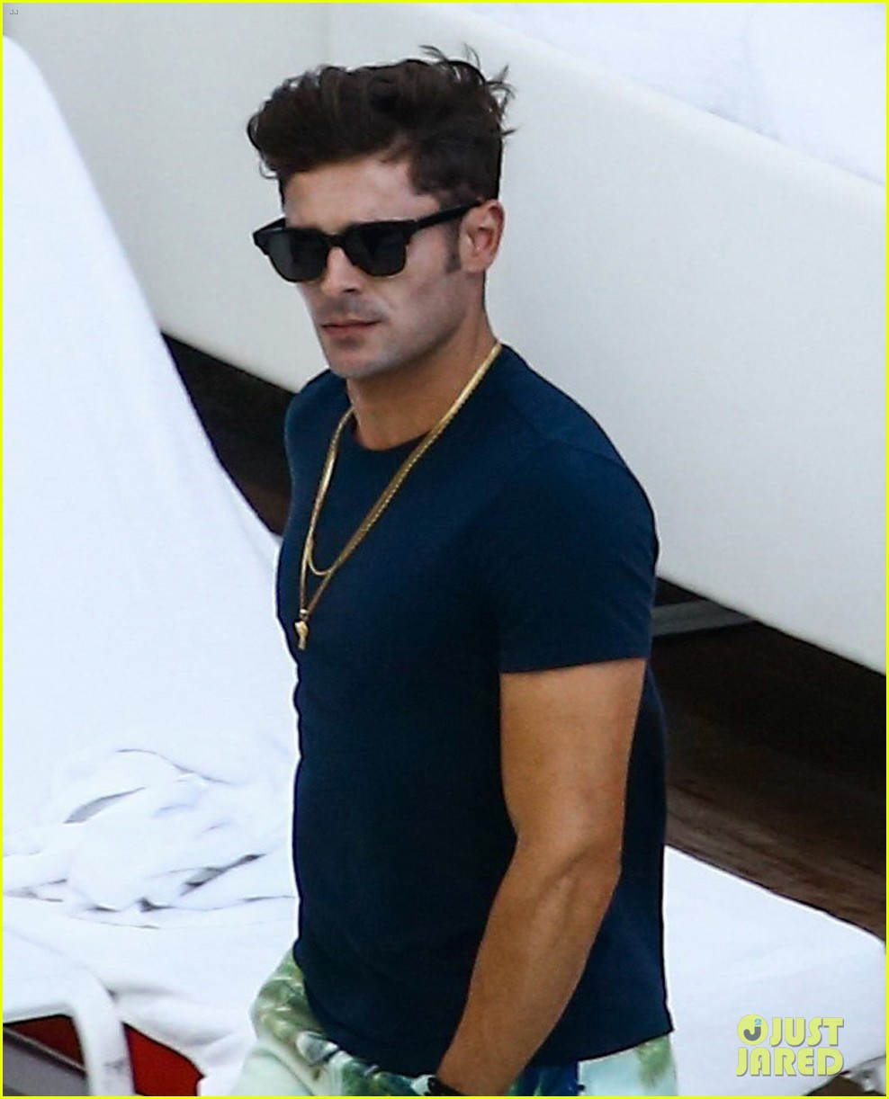 zac efron alexandra daddario hang out poolside in miami 043898365