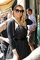 mariah carey holds pink heart balloon in the city of love 05