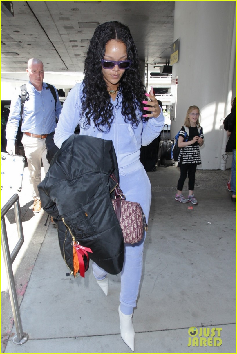 rihanna is pretty in purple velour tracksuit at lax airport 013919298