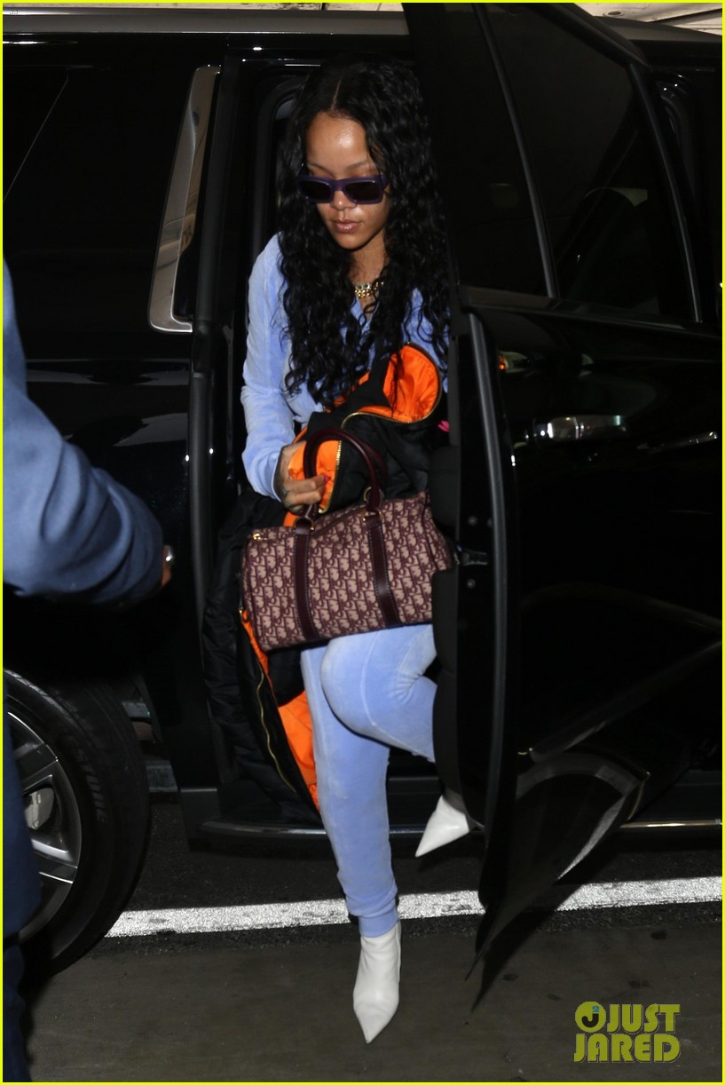 rihanna is pretty in purple velour tracksuit at lax airport 033919300