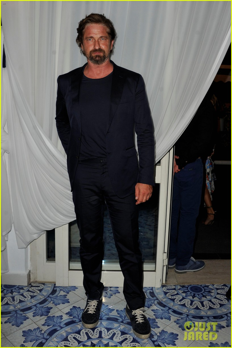 gerard butler suits up in ischia rides scooter around town 013926382