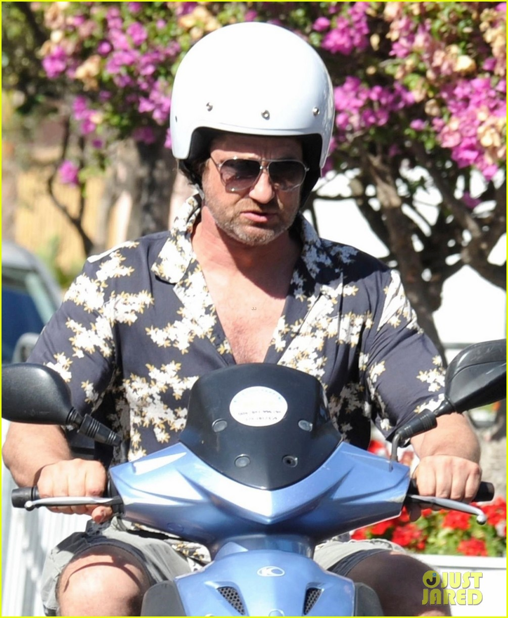 gerard butler suits up in ischia rides scooter around town 023926383