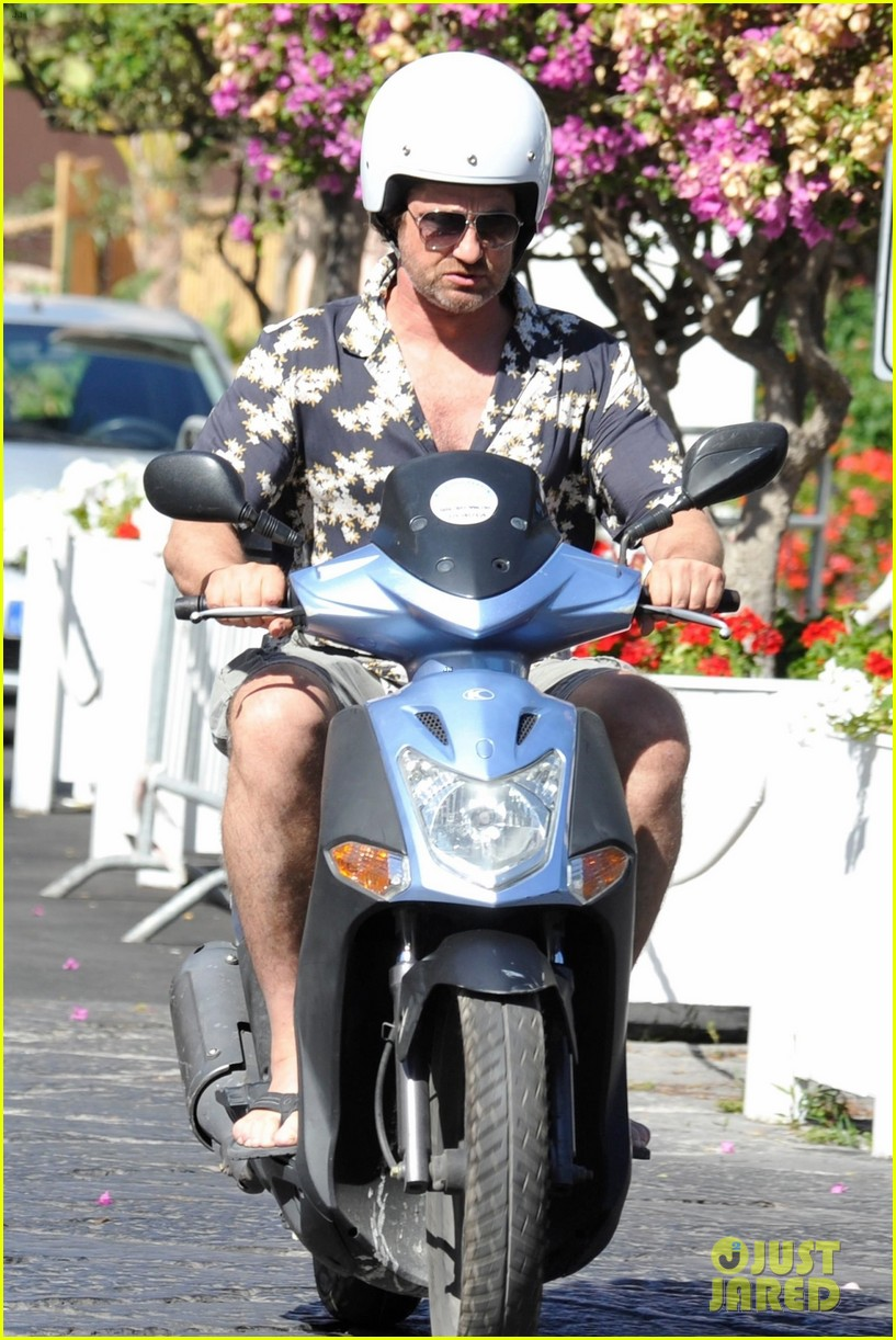gerard butler suits up in ischia rides scooter around town 053926386