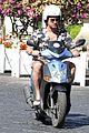 gerard butler suits up in ischia rides scooter around town 03