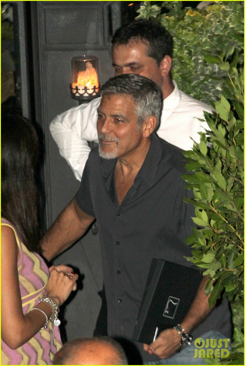 new parents george amal clooney dine with friends in italy 013926364
